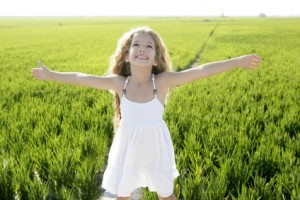 open arms little happy girl green meadow field